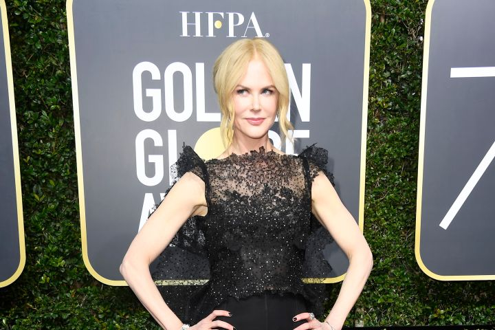 """Nominee for her role in """"Big Little Lies"""" Nicole Kidman looks beautiful in a cap sleeve lace gown on the red carpet at the 75th annual Golden Globes."""