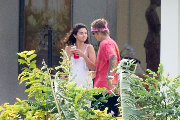 Lovebirds Justin Bieber and Selena Gomez were spotted enjoying a luxury Caribbean getaway to celebrate a family wedding in Montego Bay, Jamaica.