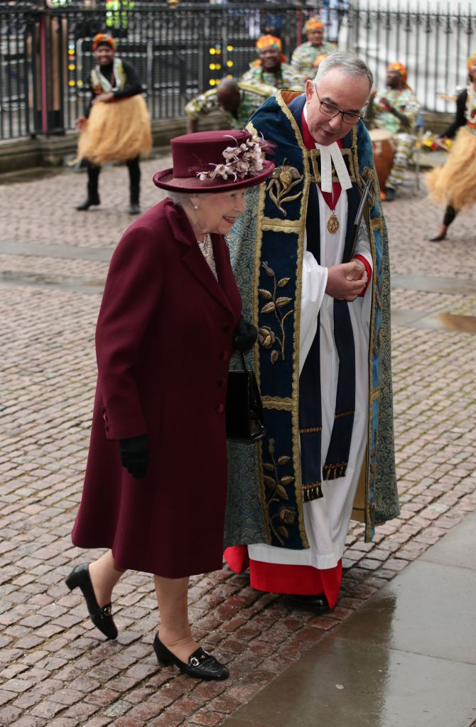 Queen Elizabeth II was escorted by Dr John Hall, the Dean of Westminster