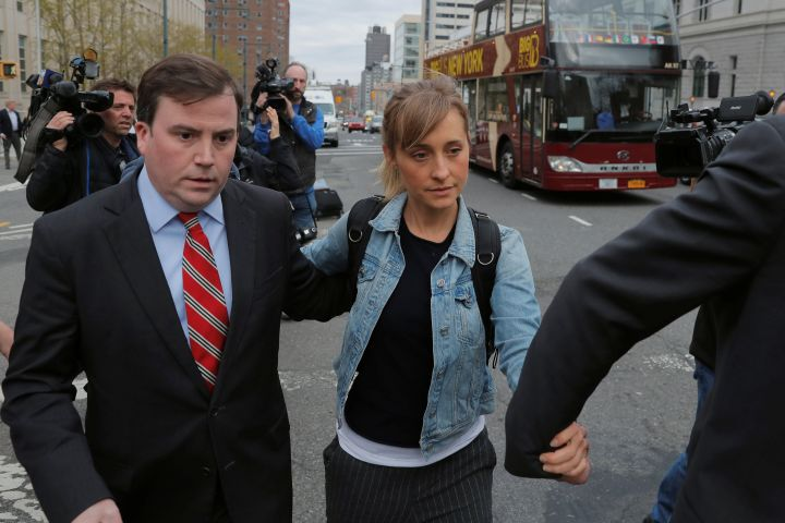 "Actress Allison Mack, known for her role in the TV series ""Smallville"", departs after being granted bail following being charged with sex trafficking and conspiracy in New York, U.S., April 24, 2018."