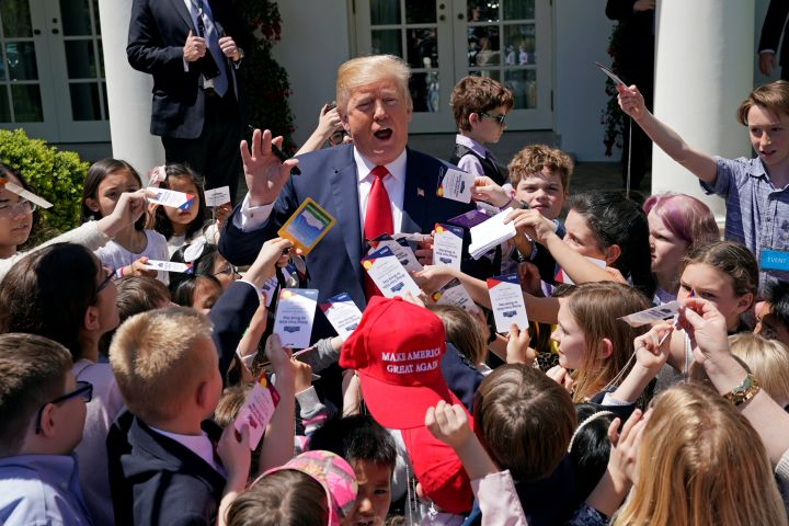 "U.S. President Donald Trump signs autographs for children of staff and press at the White House on ""take your child to work day"" in Washington. U.S., April 26, 2018. REUTERS/Kevin Lamarque"