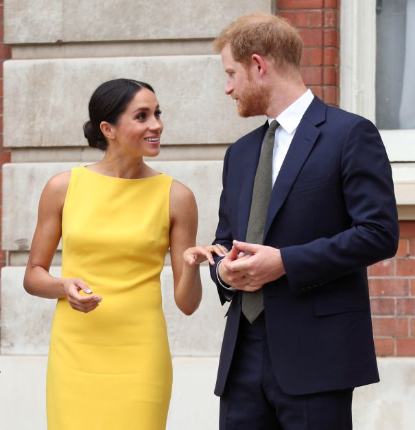 Meghan Markle Beams As She Clutches Prince Harry's Hand In London