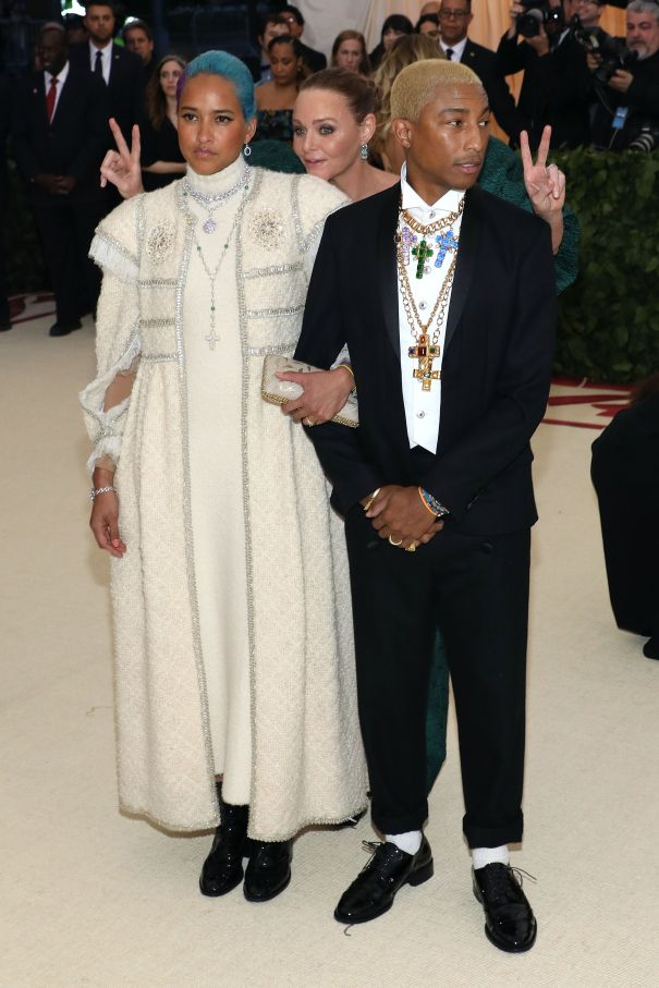 Pharrell Williams And Helen Lasichanh Get Photobombed