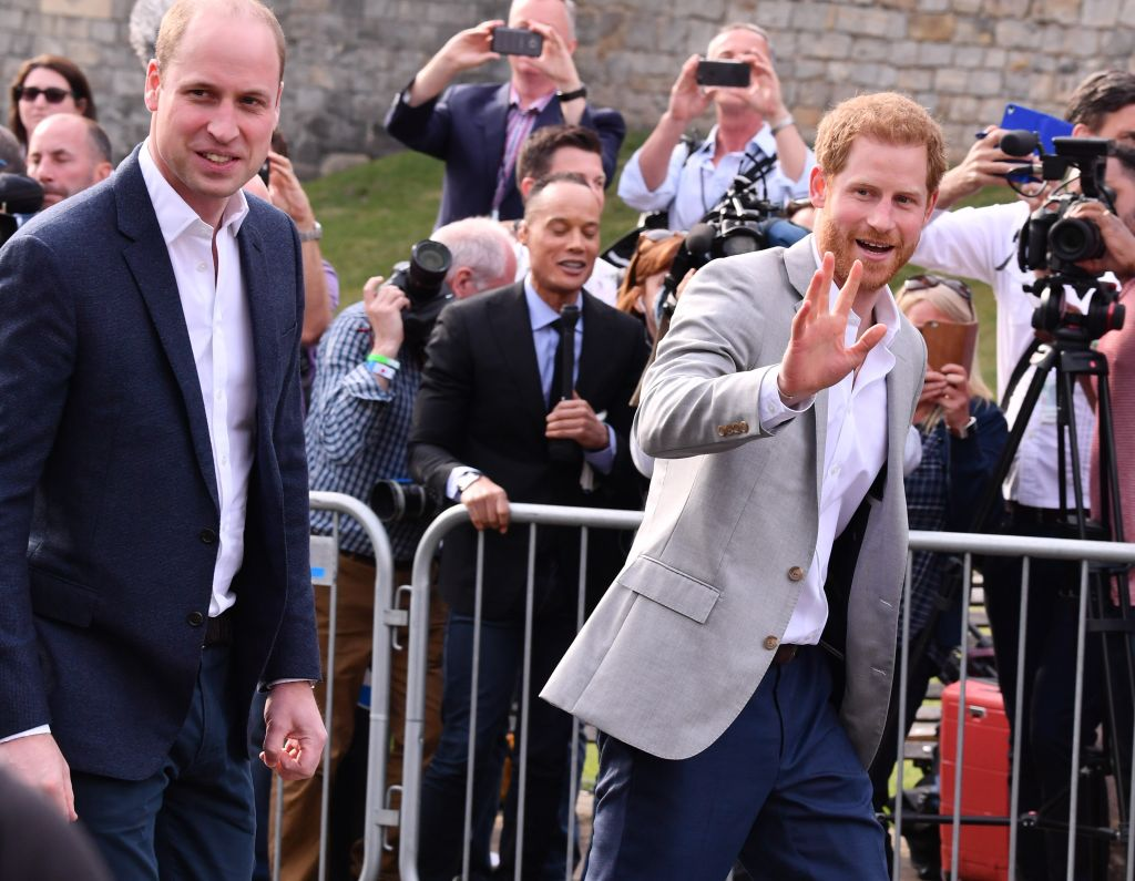 Prince Harry and his brother and best man Prince William doing a walkabout on Friday, greeting fans. Photo: George Pimentel/Getty