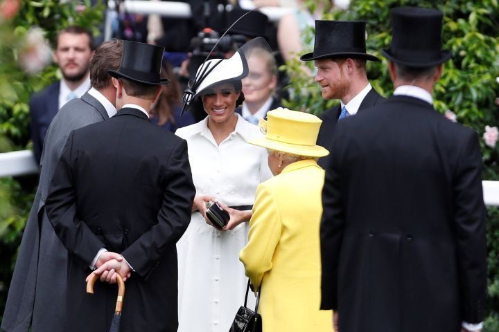 Meghan Markle greets the Queen at the event