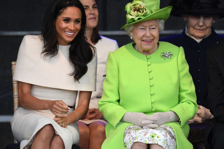 Queen Elizabeth II sits with Meghan, Duchess of Sussex during a ceremony to open the new Mersey Gateway Bridge