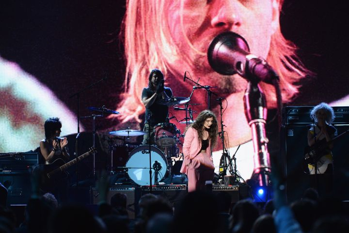Dave Grohl joined Joan Jett,  Lorde and St. Vincent onstage at the 29th Annual Rock And Roll Hall Of Fame Induction Ceremony on April 10, 2014 in New York