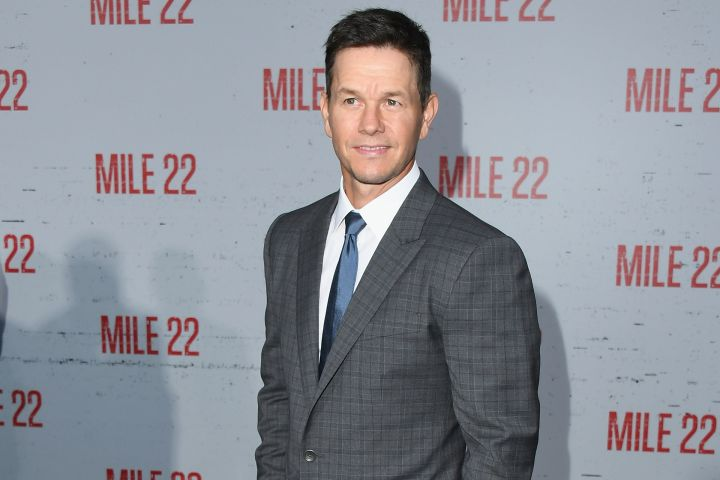 """""""Mile 22"""" CIA operative James Silva blows his cover at the movie's premiere, flashing a smile for the cameras in West Hollywood."""