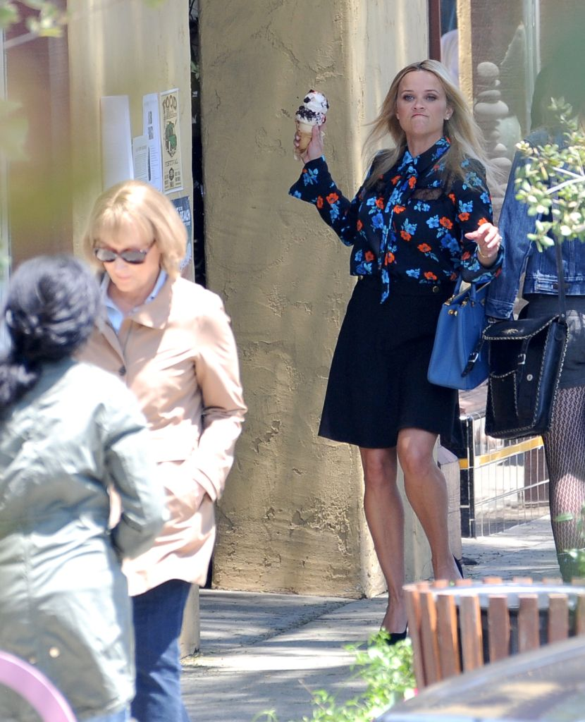 EXCLUSIVE: Reese Witherspoon gets angered and tosses her ice cream cone at her co star Meryl Streep for a scene in 'Big Little Lies' filming in Los Angeles. Witherspoon, 42, was dressed in a floral blouse, black skirt, and heels. Streep, 69, wore a tan Barbour jacket, dark jeans, and black shoes.TheImageDirect.com