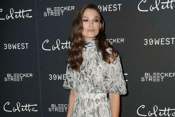 """Actress Keira Knightley, 33, arrives in NYC to premiere """"Collette"""" in an Alexander McQueen seashell-print dress."""