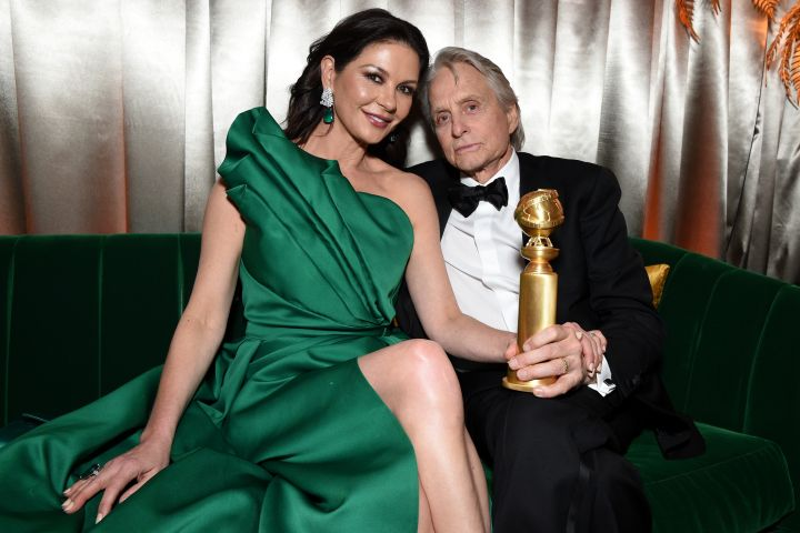 We still can't get enough of Catherine Zeta-Jones' emerald-green masterpiece, and neither can she. The actress kept on her Elie Saab gown while attending the Netflix after-party. Jones looks so in love with husband and best actor winner Michael Douglas.