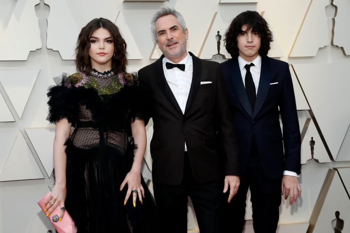 Alfonso Cuaron with his daughter Tess Bu Cuaron and son Olmo Teodoro Cuaron. REUTERS/Mario Anzuoni