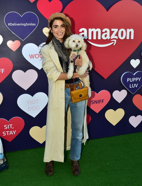 Nikki Reed Cuddles Up To A Poodle