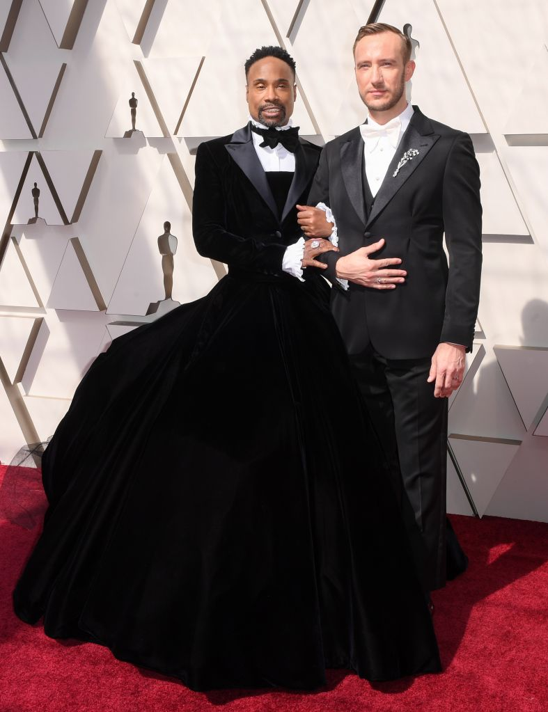 """– """"Pose"""" star Billy Porter poses with his husband Adam Smith while making a statement in a ballgown tuxedo ahead of the 2019 Oscars."""