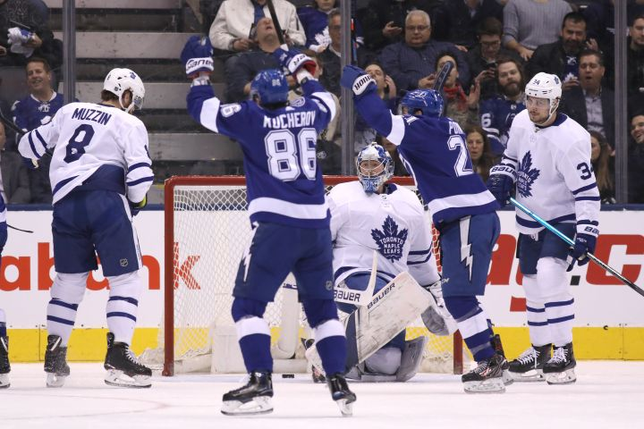 Tampa Bay Lightning right wing Nikita Kucherov (86) and centre Brayden Point (21) celebrate a goal against Toronto Maple Leafs goaltender Frederik Andersen (31) during first period NHL hockey action in Toronto on Monday, March 11, 2019.