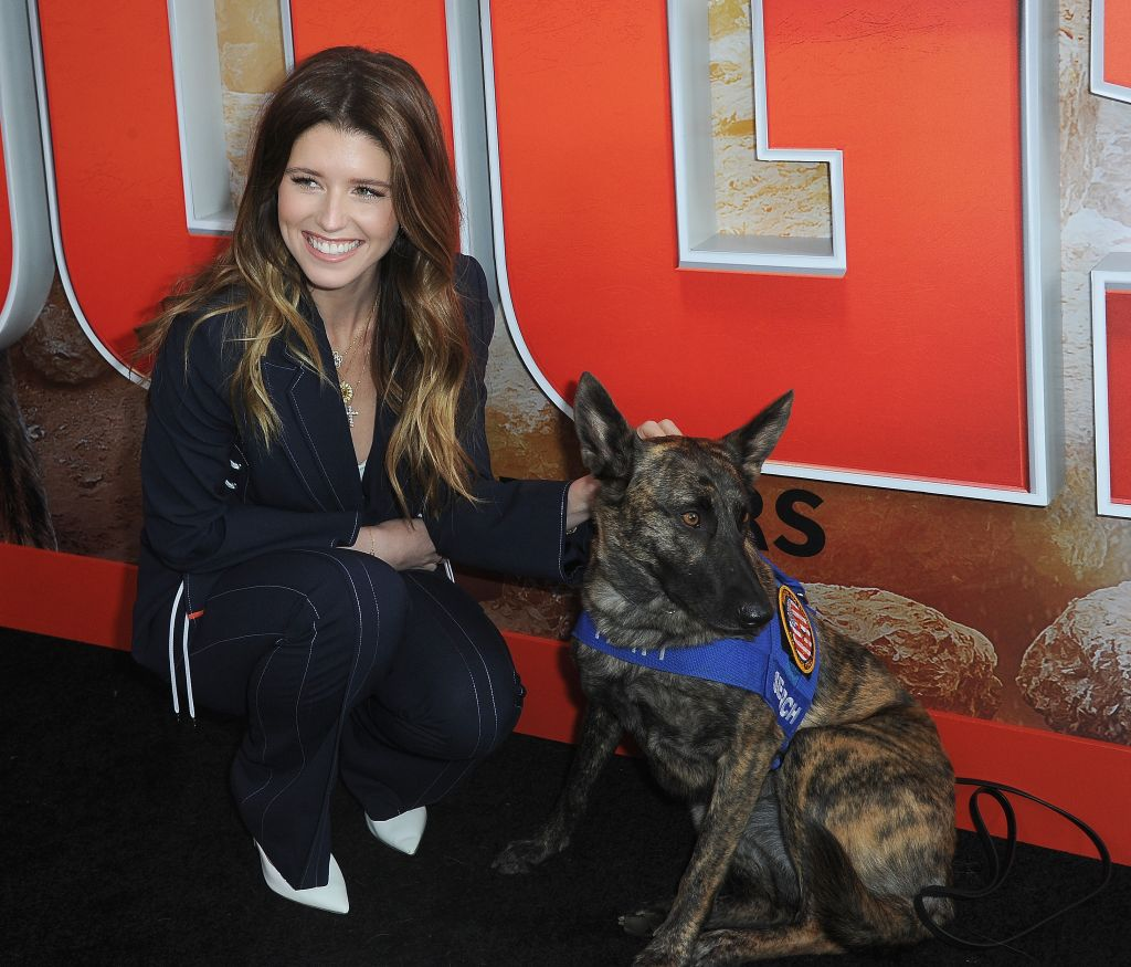 "Katherine Schwarzenegger snuggles up to Halo, the Pedigree Brand Ambassador, at the ""Superpower Dogs"" premiere."