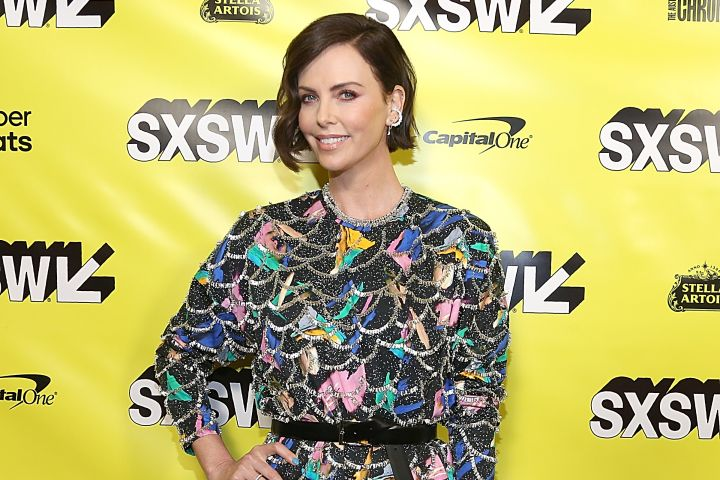 """Charlize Theron poses on the SXSW red carpet at the premiere of her new comedy, """"Long Shot""""."""