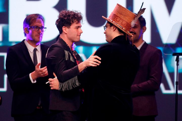 Max Kerman (L) of Arkells hugs Jeremy Dutcher after the Arkells won the 'Rock Album of the Year' during the Juno Awards Gala in London, on March 17, 2019.