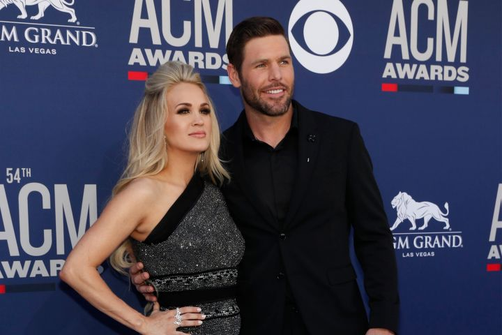 54th Academy of Country Music Awards – Arrivals – Las Vegas, Nevada, U.S., April 7, 2019 – Carrie Underwood and Mike Fisher. REUTERS/Steve Marcus
