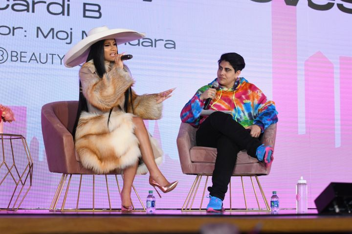 Cardi B and Moj Mahdara on stage at Beautycon NYC. Photo by Noam Galai/Getty Images for Beautycon