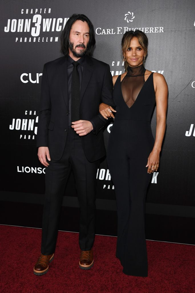 """Keanu Reeves and Halle Berry link arms as they attend the world premiere of """"John Wick: Chapter 3"""" in New York City."""