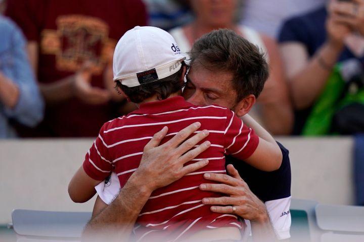Nicolas Mahut and son Natanel. Photo: KENZO TRIBOUILLARD/AFP/Getty Images