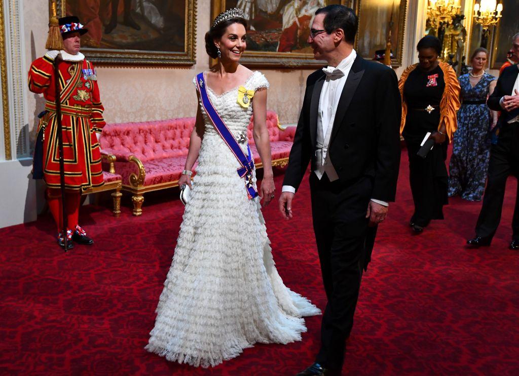 Duchess of Cambridge walks with US Secretary of Treasury Steven Mnuchin. VICTORIA JONES/AFP/Getty Images
