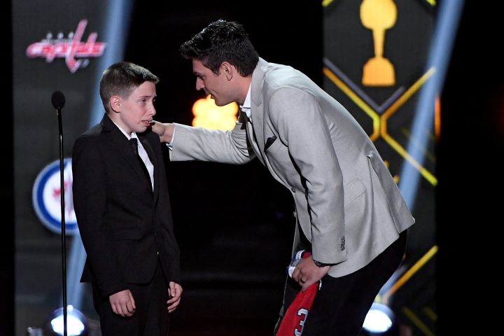 11-year-old Anderson Whitehead and the Canadiens' Carey Price. Photo: Ethan Miller/Getty Images