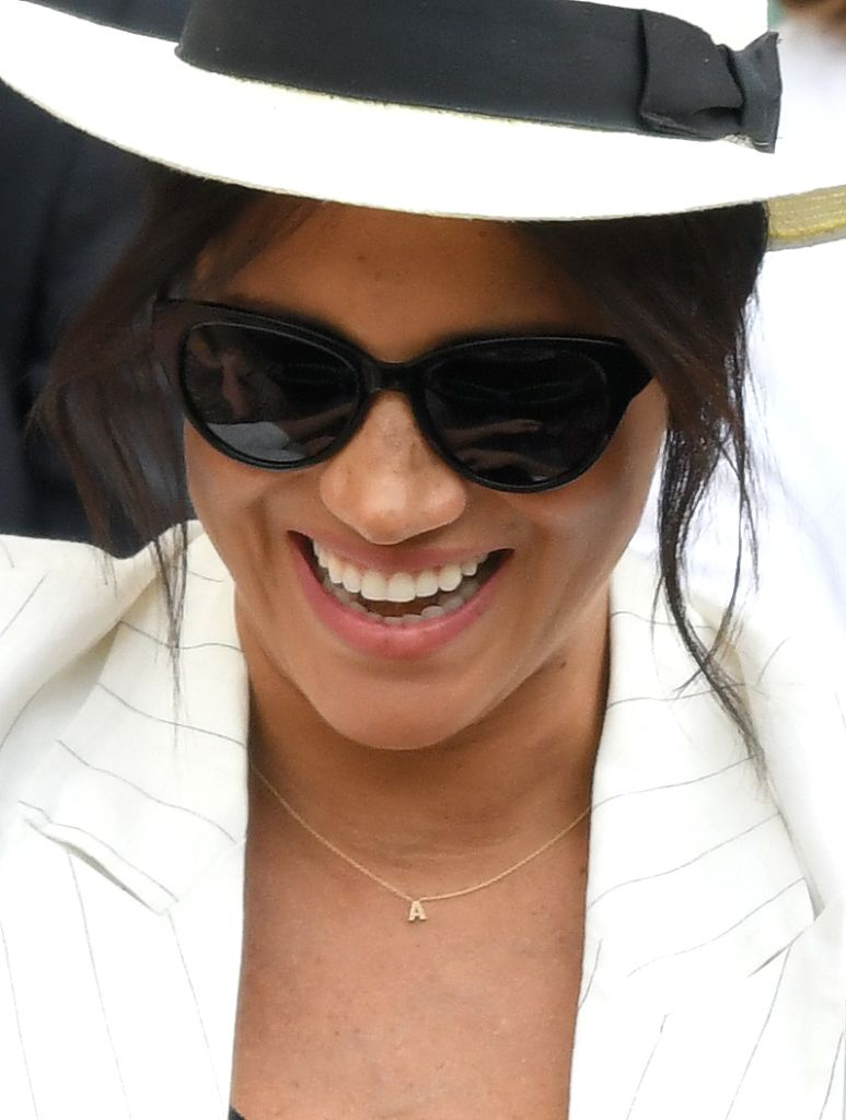 LONDON, ENGLAND – JULY 04: Meghan, Duchess of Sussex, necklace detail, attends day four of the Wimbledon Tennis Championships at All England Lawn Tennis and Croquet Club on July 04, 2019 in London, England. (Photo by Karwai Tang/Getty Images)