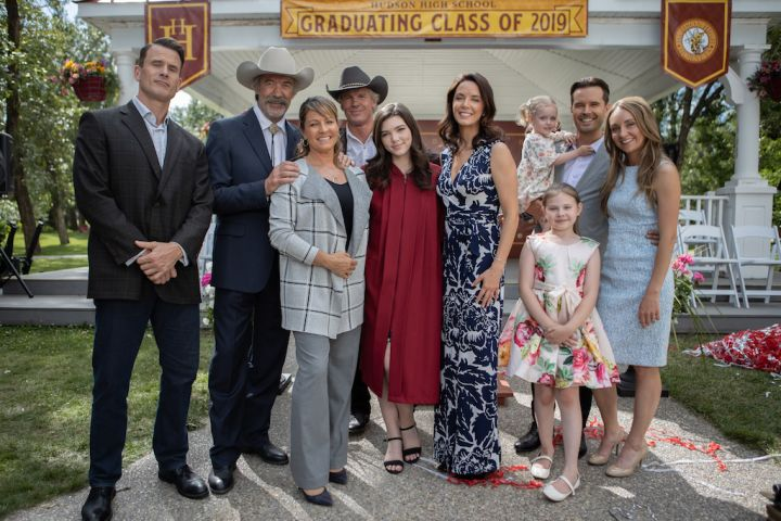 "Georgie's Graduation Day – Georgie, played by Alisha Newton celebrates her high school graduation with the ""Heartland"" family. Left to right: Peter Morris (Gabriel Hogan), Jack Bartlett (Shaun Johnston), Lisa Stillman (Jessica Steen), Tim Fleming (Chris Potter), Lou Fleming (Michelle Morgan), Lyndy (Ruby and Emmanuella Spencer), Katie (Ziya Matheson), Ty Borden (Graham Wardle), Amy Fleming (Amber Marshall)."