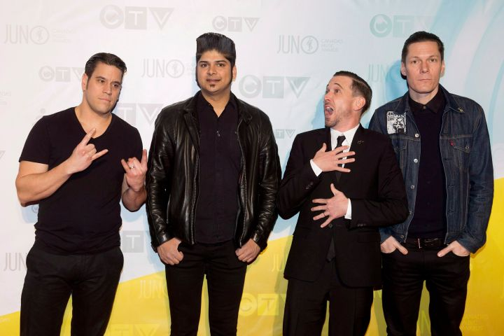 Billy Talent pose for photographs on the red carpet during the 2013 Juno Awards in Regina on Sunday, April 21, 2013.