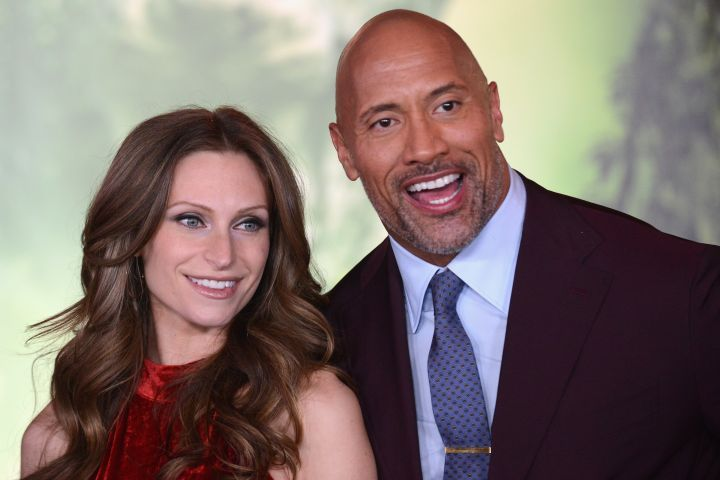 """HOLLYWOOD, CA - DECEMBER 11:  Actor Dwayne """"The Rock"""" Johnson and Lauren Hashian arrive for the Premiere Of Columbia Pictures' """"Jumanji: Welcome To The Jungle""""  held at The TLC Chinese Theater on December 11, 2017 in Hollywood, California.  (Photo by Albert L. Ortega/Getty Images)"""