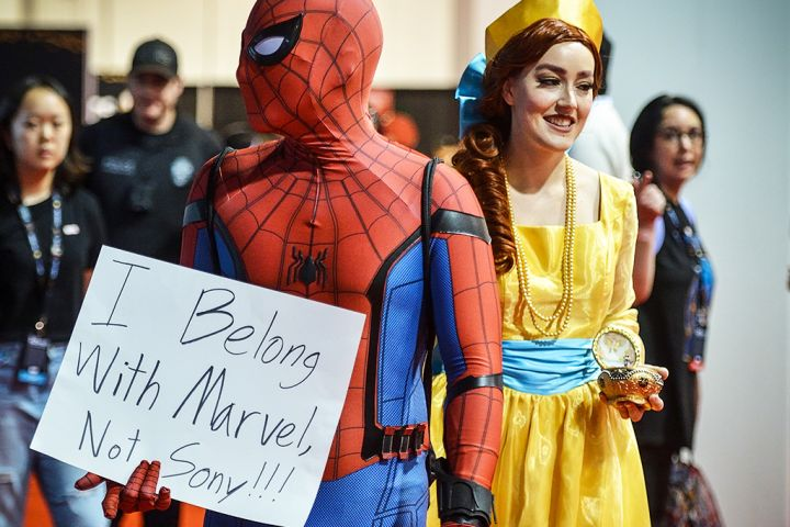 Dane Collaro, dressed as Spider-Man, shows his displeasure with the Sony/Disney spat over the web slinger, as he walks through the D23 Expo with his girlfriend Lauren Wood, dressed as Anastasia, in Anaheim, Calif., on Friday, Aug 23, 2019.