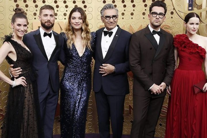 Cast members of 'Schitt's Creek' arrive for the 71st annual Primetime Emmy Awards ceremony held at the Microsoft Theater in Los Angeles, Calif., on Sept. 22, 2019.