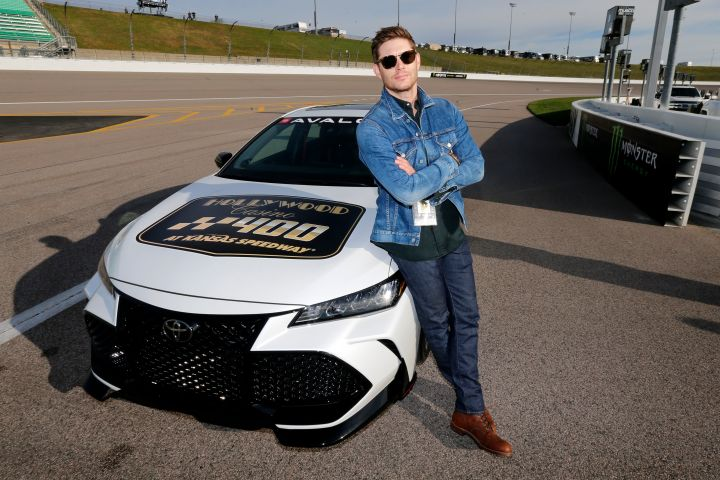 Jensen Ackles poses by the Grand Marshall pace car before the Monster Energy NASCAR Cup Series Hollywood Casino 400 at Kansas Speedway on October 20, 2019 in Kansas City, Kansas.