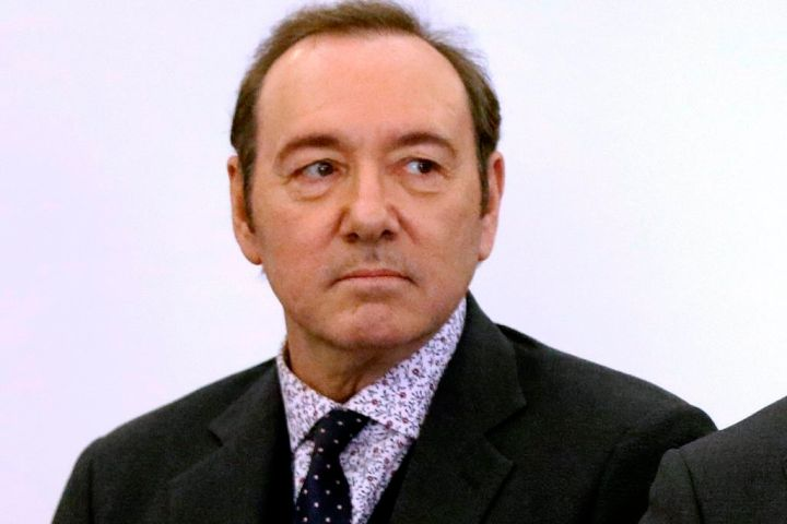 Actor Kevin Spacey stands in district court during arraignment on a charge of indecent assault and battery in Nantucket, Mass.