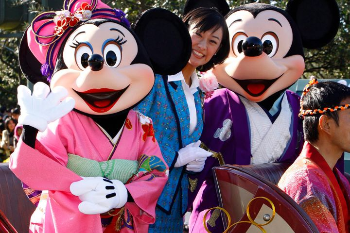 In this Jan. 1, 2010 file photo, Mickey Mouse and Minnie Mouse characters wave to visitors and guests during the annual Disney characters' procession at the Tokyo Disneyland in Urayasu, near Tokyo, Japan.