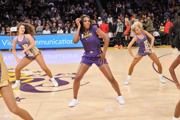 Venus Williams dances with the Laker Girls during halftime at a basketball game between the Los Angeles Lakers and the Oklahoma City Thunder at Staples Center on November 19, 2019 in Los Angeles, California. (Photo by Allen Berezovsky/Getty Images)