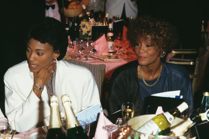 Robyn Crawford (L) and Whitney Houston