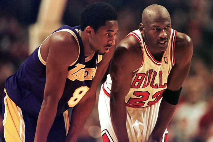CHICAGO, UNITED STATES:  Los Angeles Lakers guard Kobe Bryant(L) and Chicago Bulls guard Michael Jordan(R) talk during a free-throw attempt during the fourth quarter 17 December at the United Center in Chicago. Bryant, who is 19 and bypassed college basketball to play in the NBA, scored a team-high 33 points off the bench, and Jordan scored a team-high 36 points. The Bulls defeated the Lakers 104-83.  AFP PHOTO  VINCENT LAFORET (Photo credit should read VINCENT LAFORET/AFP via Getty Images)