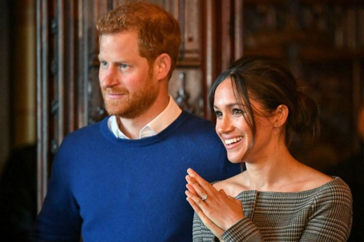 Prince Harry and Meghan Markle watch a performance by a Welsh choir in the banqueting hall during a visit to Cardiff Castle. PRESS ASSOCIATION Photo. Picture date: Thursday January 18, 2018. Ben Birchall/PA Wire