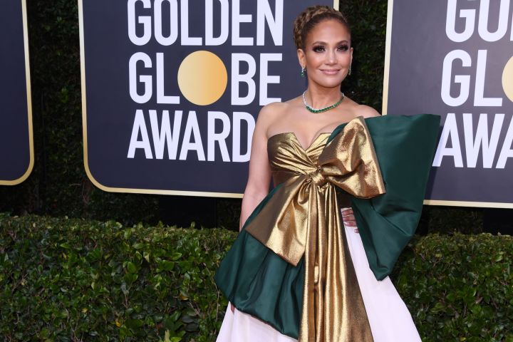 Jennifer Lopez shuts down the Golden Globes red carpet in a stunning Valentino Haute Couture ball gown.