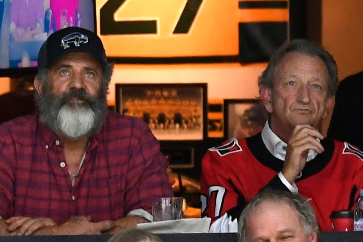 Actor Mel Gibson and Ottawa Senators owner Eugene Melnyk watch the Senators and Buffalo Sabres in NHL hockey action in Ottawa, Tuesday, Feb. 18, 2020.   THE CANADIAN PRESS/Justin Tang