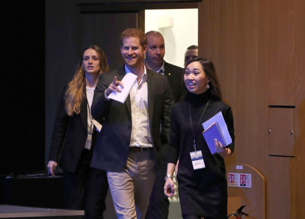 Britain's Prince Harry, centre, arrives for a sustainable tourism summit at the Edinburgh International Conference Centre in Edinburgh, Scotland, Wednesday, Feb. 26, 2020. (Andrew Milligan/Pool Photo via AP)