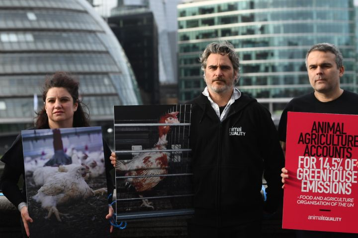 Actor Joaquin Phoenix (centre) after supporting the unfurling of a banner on Tower Bridge in central London, during an Animal Equality protest to draw attention to the effects of animal agriculture on the environment. (Photo by Victoria Jones/PA Images via Getty Images)