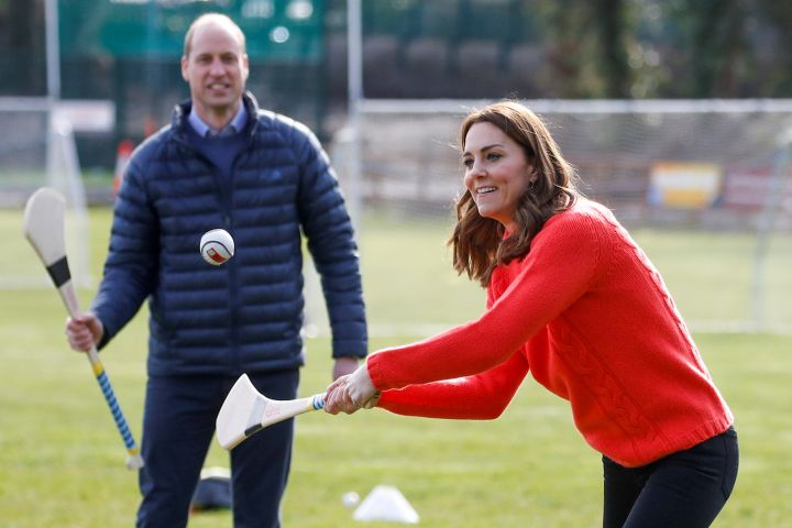 The Duke and Duchess of Cambridge play hurling during a visit to the local Gaelic Athletic Association Club in Galway.