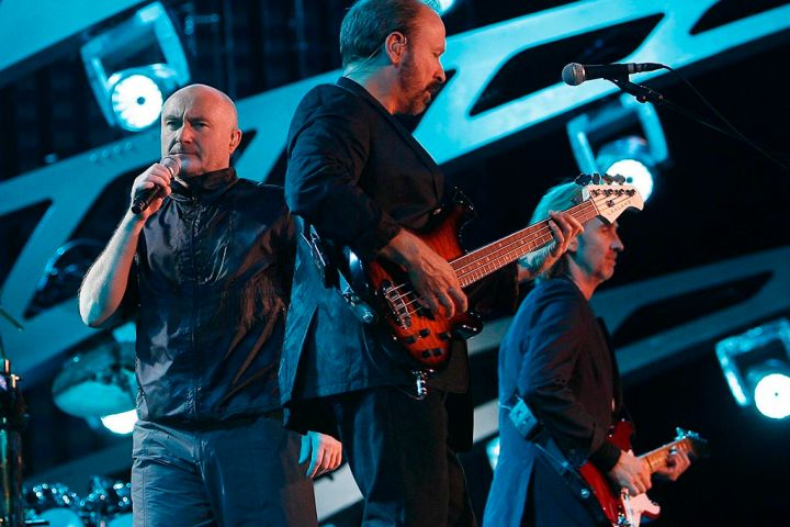 (L-R) Phil Collins, Daryl Stuermer and Mike Rutherford perform live onstage during a free concert of British rock band Genesis, as part of their Turn It On Again world tour, at Circus Maximus in Rome, Italy on July 13, 2007.