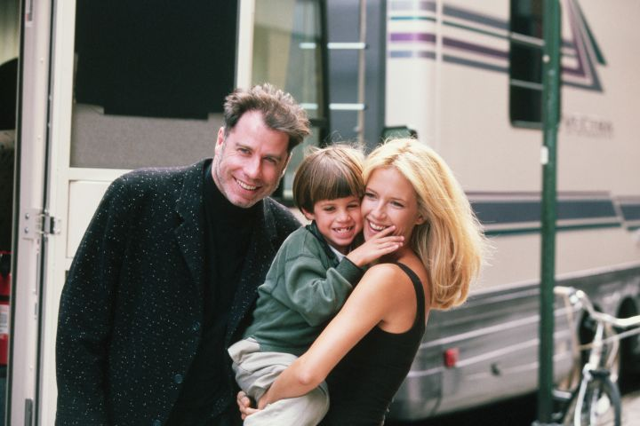 """Actress Kelly Preston gets a visit from husband John Travolta (L) and son Jett while on location filming the 1997 motion picture """"Addicted to Love.""""   (Photo by Mitchell Gerber/Corbis/VCG via Getty Images)"""
