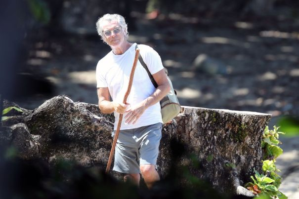 Pierce Brosnan Takes A Solo Hike In Hawaii
