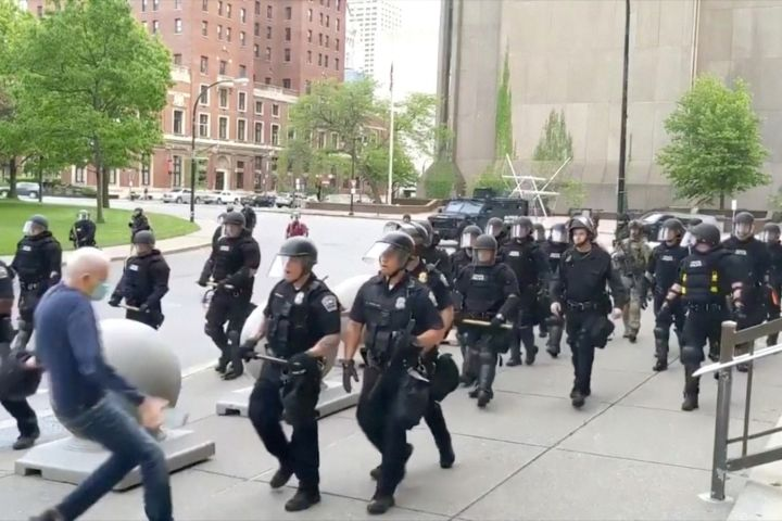 An elderly man falls after appearing to be shoved by riot police during a protest against the death in Minneapolis police custody of George Floyd, in Buffalo, New York, U.S. June 4, 2020 in this still image taken from video.